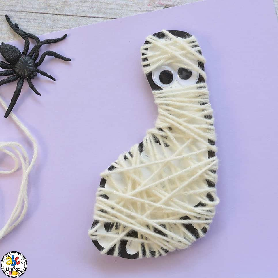 Celebrate Halloween by making this fun Footprint Mummy Craft. This footprint craft is cute and easy to make. This Halloween craft is a festive decorate too.