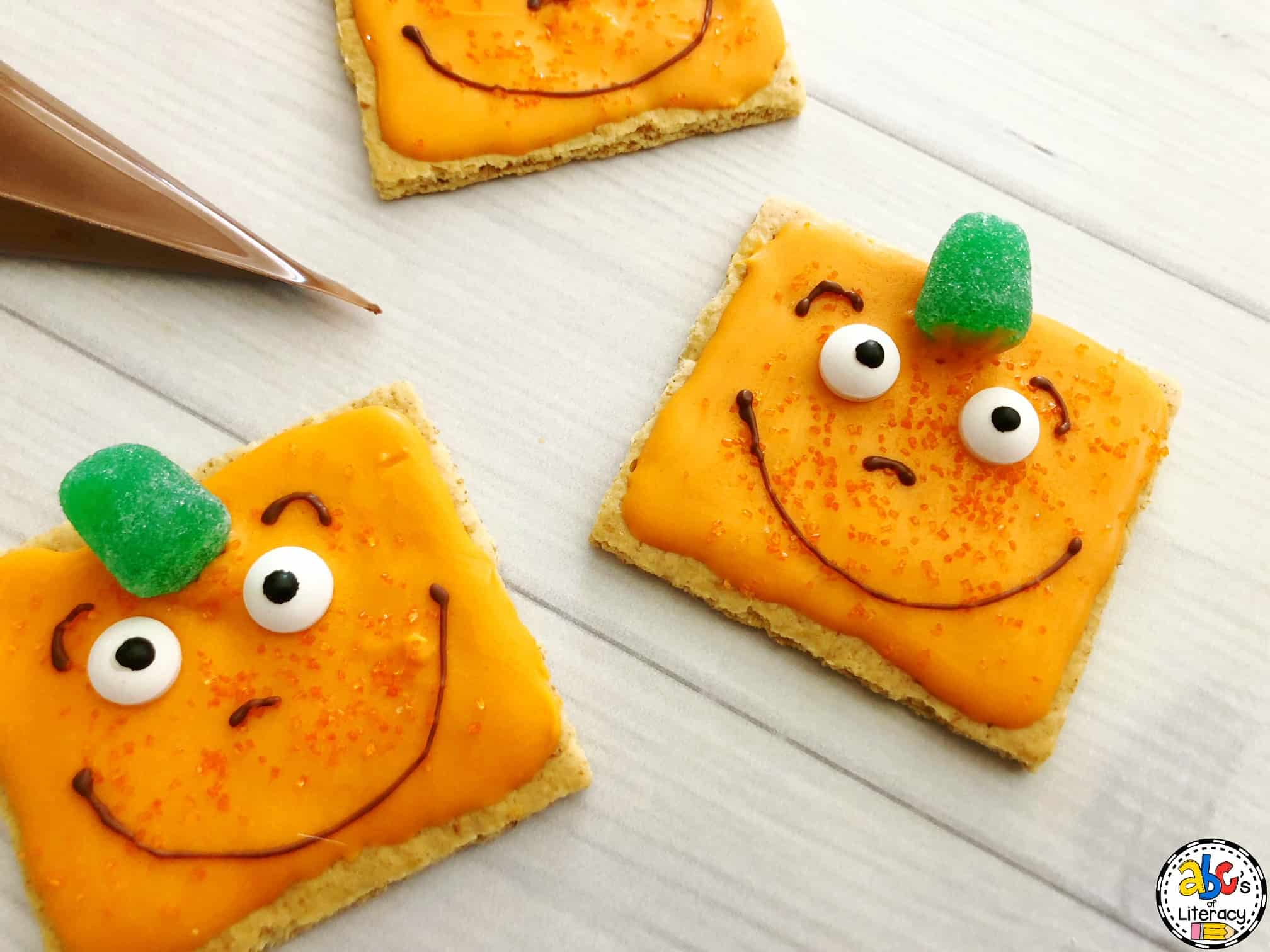 This Spookly the Square Pumpkin Snack is easy to make and delicious to eat. They are the perfect picture book activity during any Halloween party.